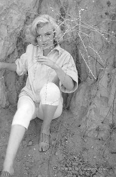Marilyn in 'Rock' sitting photographed by Milton H. Greene 1953.
