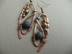 Unique copper wire wrapped earrings with black volcanic lava beads, and glass beads. Rustic and antiqued.  1 3/4 inches long & 2/3 inch wide.