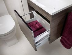The compact vanity unit, seen here in grey brown linear, ideal for any cloakroom Fitted Bathroom Furniture, Drawer Runners, Modular Furniture, Vanity Units, Brown And Grey, Halo, Drawers, Contemporary, Alone