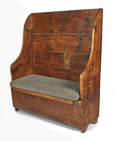 Pine settle bench, early 19th c., 59 1/4'' h., 50'' w.
