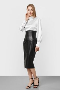 Blonde modeling high waisted black leather midi skirt white silk blouse and ankle strap heels