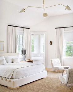 Serge Mouille Ceiling Lamp in an all white bedroom. Julie Hillman Interior Design