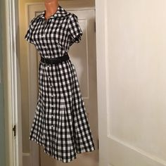 Beautiful summer dress! Black and white checks, gored skirt for lots on movement when you walk, buttons up the front, cotton blend so wash and wear. Comes without a belt. Evan Picone Dresses Midi