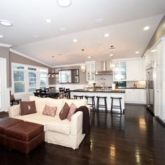 open concept floor plan with large rectangular kitchen counter
