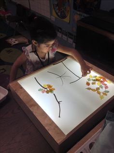 Use real sticks and plastic leaves on the light table to create fall trees.