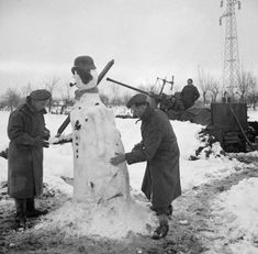 Gunners build a snowman near their 40mm Bofors anti-aircraft gun Italy 6 January 1945.