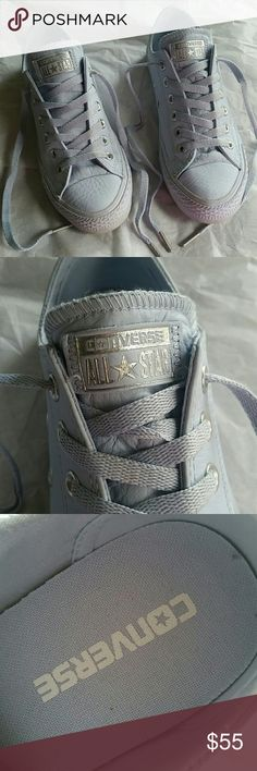 Pure silver converse All star low leather porpoise pure silver snake exclusive converse.  They are like new condition only a little dirt on the soles, my daughter worn them twice only.  Size 7 women's. Converse Shoes Sneakers