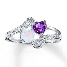 A heart-shaped amethyst perfectly complements a heart-shaped lab-created opal in this whimsical sterling silver ring for her. Diamond accents complete the look.  Gently clean by rinsing in warm water and drying with a soft cloth.