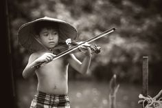 #black and white #blur #boy #child #classic #fun #kid #leisure #little #love #music #musical instrument #musician #native #outdoors #people #person #portrait #summer #talent #violin #wear #young