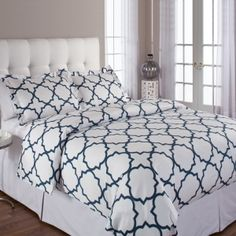 Quatrefoil Duvet Set by Echelon.   Brackets duvet cover sets featur… Love this!  I'd put solid navy pillows with it and then accent with two yellow pillows in front