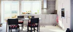White kitchen with brick walls