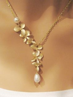 Sanari - GOLD Orchids and Swarovski Pearl gold necklace. $32.00, via Etsy.