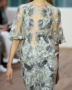 A model (detail) walks the runway at the Julien Macdonald show during London Fashion Week Spring Summer 2015 at the Royal Opera House on September 13, 2014 in London, England.