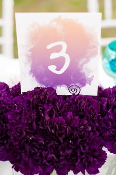 Purple Ombre Wedding Ideas (i love the idea of the Table Number sitting in a bed of flowers!)
