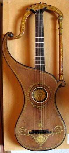 harp guitar, I'd want to add strings in the harp area, too