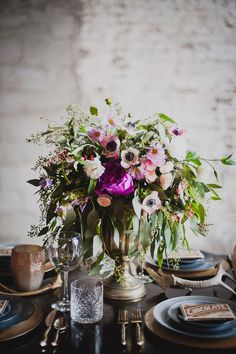 purple floral arrangement with anemones - photo by Khaki Bedford Photography http://ruffledblog.com/brooklyn-meets-nashville-wedding-inspiration