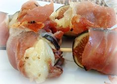 Grilled figs stuffed with brie, and wrapped with prosciutto. Awesome for a tapas plate! The chef suggests rosemary branches for skewers, and a balsamic reduction drizzle.