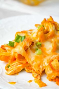 Buffalo Chicken Frito Pie is an easy casserole recipe using shredded rotisserie chicken and diced celery tossed in Buffalo sauce and ranch dressing, all topped with Fritos corn chips and cheese. Cheesy Chicken Casserole, Chicken Bacon Ranch Bake, Buffalo Chicken, Beef Recipes For Dinner, Ground Beef Recipes, Vegan Recipes Easy, Diet Recipes, Recipes Using Rotisserie Chicken, Chicken Recipes