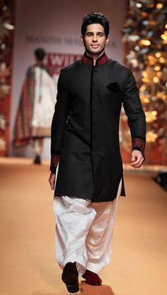 Actor Sidharth Malhotra walks the ramp for designer Manish Malhotra during the Wills Lifestyle India Fashion Week in New Delhi. (PTI)