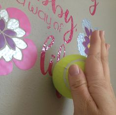 Use a tennis ball to get vinyl to stick to textured walls. SMART! #whydidntithinkofthat