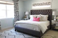 Graphic drapes, soft gray walls, upholstered bed
