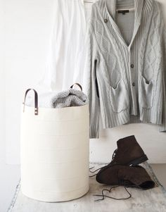 This elegant, simple, fully lined hamper with French seam detailing and leather handles will make a perfect housewarming gift as well as beautiful touch to your beautiful home. As its made of 100% cotton canvas it is very durable and hard wearing. Great for getting organized around the house - storage toys in kids room or nursery, dirty clothes in wardrobe or laundry room, towels in bathroom.  SIZES Approx. 45 cm / 17.7 (H) x 34 cm / 13.4 (D) Purchase this basket in size approx. 29 cm…