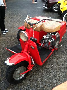 Cushman Scooter with sidecar.