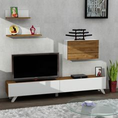 A TV stand gives you easy access to all the cables and sockets should you need to change them. A TV unit gives you an even more space. Get our CATERINA White and Walnut TV Unit for only $382.53!  Tags: #doseofmodern #homedecor #furniture #decor #interior #homedesign #tv #furnituredesign #television #decoration #interiors #tvshow #instadesign #instahome #series #livingroom #bedroom #woodworking #decorating #sofa #radio #wood #interiordesigner #homestyle #instadecor #homesweethome… Tv Unit Furniture, Furniture Design, Furniture Decor, Retro Tv Stand, Modern Tv Units, Tv Stand With Storage, Memorial Day Sales, Large Shelves, Front Rooms