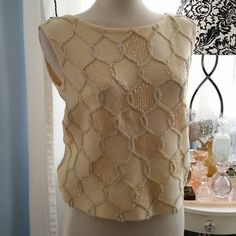 Check out this item in my Etsy shop https://www.etsy.com/listing/272200988/gorgeous-vintage-cream-knit-shift-top