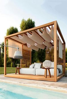 Wooden blinds and natural white fabric for making outdoor space little more private