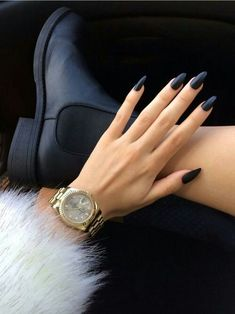 Fur. Gold watch. Pointy black nails.