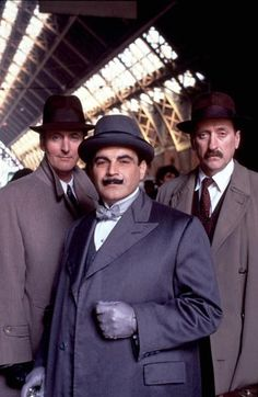 Hercule Poirot with Captain Hastings and Inspector Japp