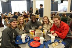 Jesse Bingham eating with friends in the caf