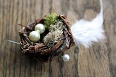 LOVE NEST BOUTONNIERE . Bird nest, moss, feather and pearl boutonniere. $16.00, via Etsy.