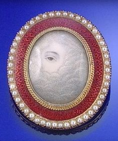An enamel and seed-pearl brooch/pendant, c.1810, enclosing a lover's eye surrounded by clouds, signifying that the loved one is in heaven.