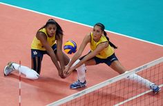 Fernanda Rodrigues #16 and Jaqueline Carvalho #8 of Brazil