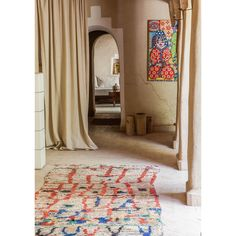 "Berber rug with Fatiha Eddahriz's painting at DarZahia. Photo © Robert Holden - Courtesy of ""Elle Decor Italia"". #darzahia #guesthouse #bedandbreakfast #house #interior #morocco #taroudant #gardenlovers #rug #berberrugs #simplelife #selfsustainable #handcraft #adobehouse #naivepainting"