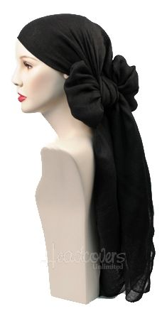 simple bow tied in back could be simpering sweet but classic in basic black