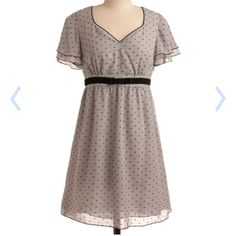 """Gray Heart Polka Dot Dress Gray dress with black heart polka dots in excellent condition. Loose seining short sleeves and velvet waist bow detail. Side zipper closure. Hits about the knee on me and I'm a little shy of 5'4"""". ModCloth Dresses"""