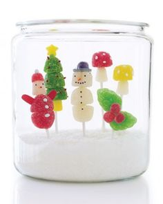 Gumdrop Pops in a Jar:  Fill a large glass jar with sanding sugar, and place homemade figurines on flower frogs in the sparkling snow for a beautifully edible gift.