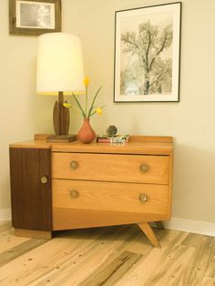 This bedroom features a beetle-kill pine floor and reclaimed trim and baseboards. The dresser was a thrift-store find.
