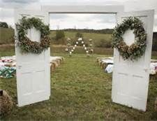 i like the idea of the doors...not with wreaths though...maybe initials.