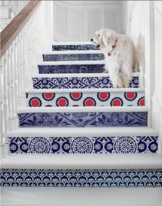 use wallpaper remnants for the back of stairs - great for the basement or attic stairs