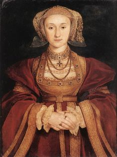 This is a painting of Anne Cleeves, fourth wife of Henry VIII, by Hans Holbein the Younger (1497-1543). It was on the basis of this portrait that Henry VIII chose her to be his fourth Queen. She was from France and introduced some French influence on the dress.