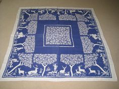 Vintage blue and white tablecloth. Hand printed linen with deer, hunters, does and stages and stylized trees. Probably 1940's. (NeatoKeen/Etsy)