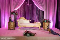Love the decor elements and the pink lighting : Photo by Harvard Photography