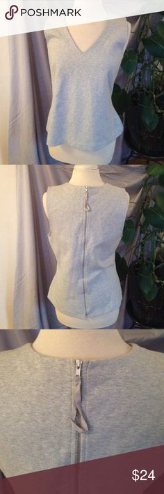 """Sale! J. Crew Gray Top J. Crew, sweatshirt material top, exposed zipper in back, sleeveless. Size large. Material: 70% cotton, 35% nylon, 5% spandex. Length: 22.5"""". Pre-loved, beautiful condition. J. Crew Tops"""