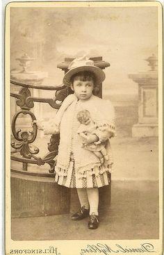 Sweet little girl holding her doll.