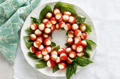 Christmas caprese wreath - This festive no-cook dish will make the perfect centerpiece for your Christmas table.