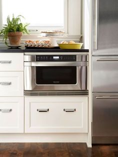 Perfectly snug in bottom cabinets. It's not the prettiest home appliance anyways... Might as well let it not be a focal point. #WhiteHomeAppliances